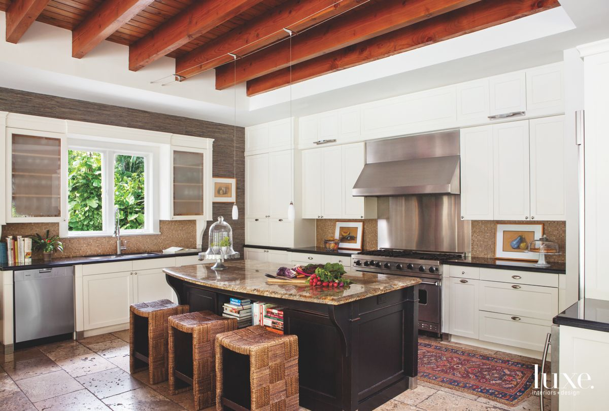 Red Wood Beam Ceiling Kitchen with White Kitchen Cabinets and Glass Cloche