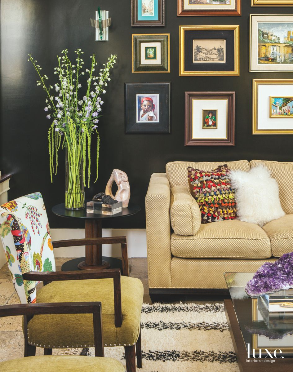 Black Wall of Art in Frames with Sofa and Patterned Chair