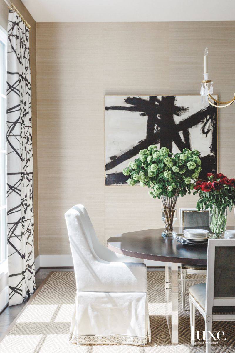 Black and White Artwork with Matching Curtains and Flowers Dining Room