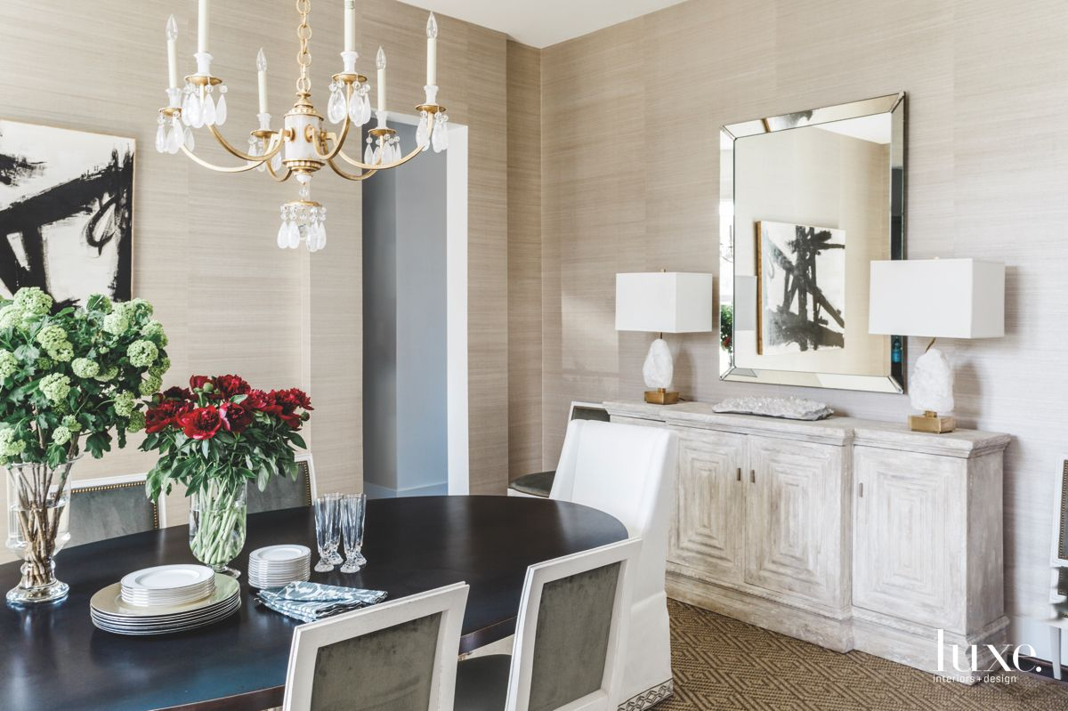 Mirror and Chandelier Neutral Dining Room with Flowers
