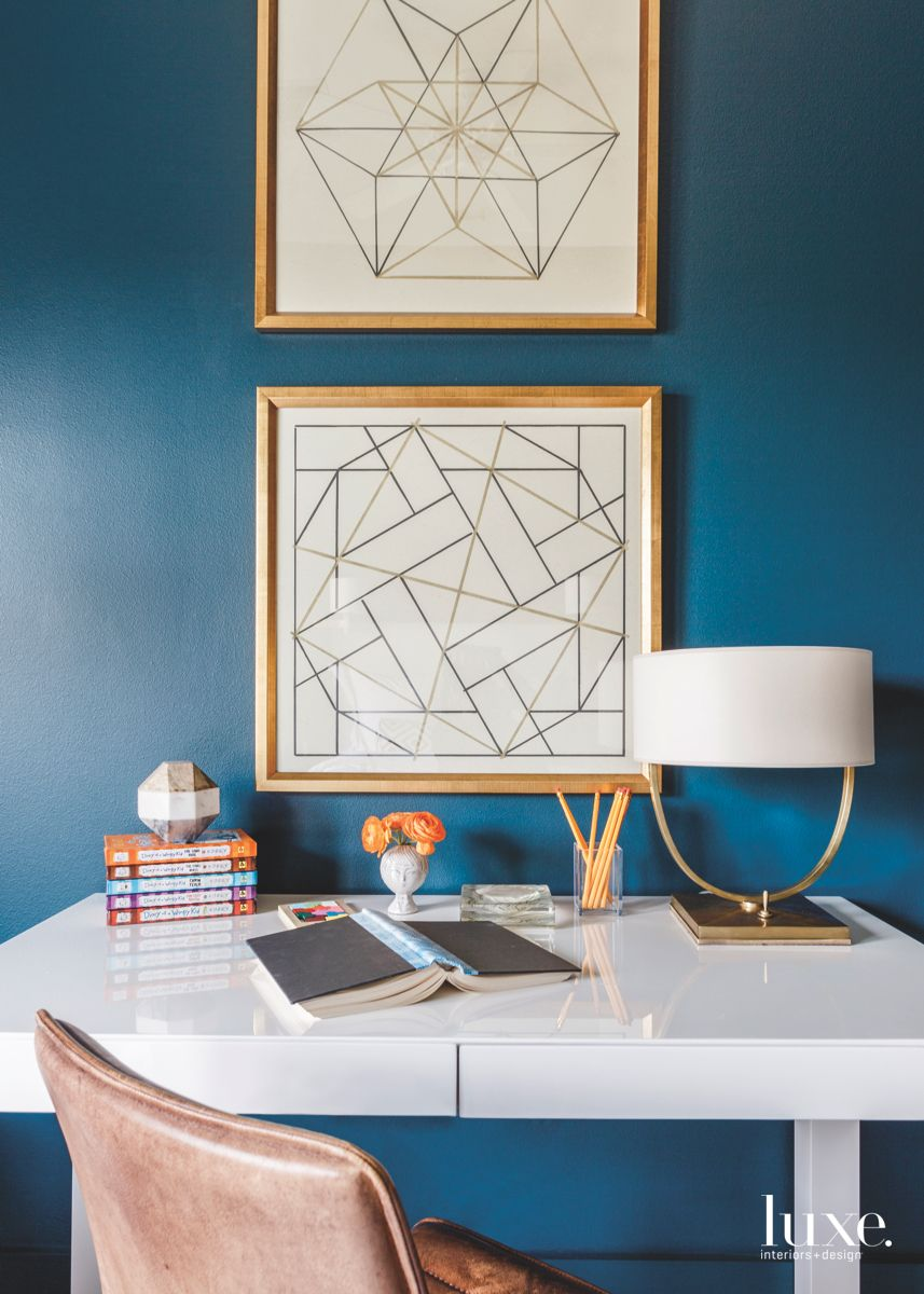 Child's Blue Room with Geometric Artwork and Lamp