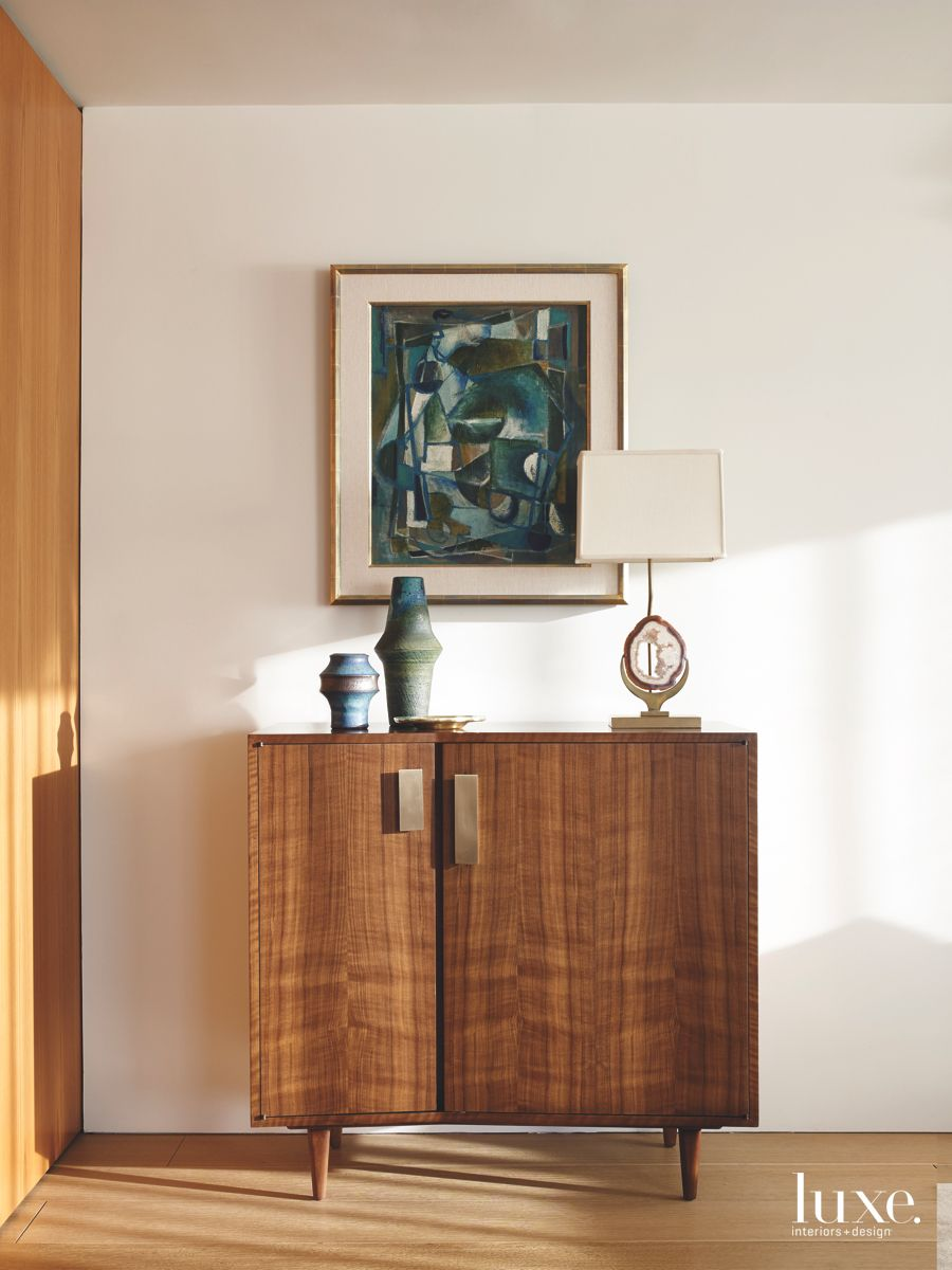 Hallway Vignette with Midcentury Artwork and Wooden Chest