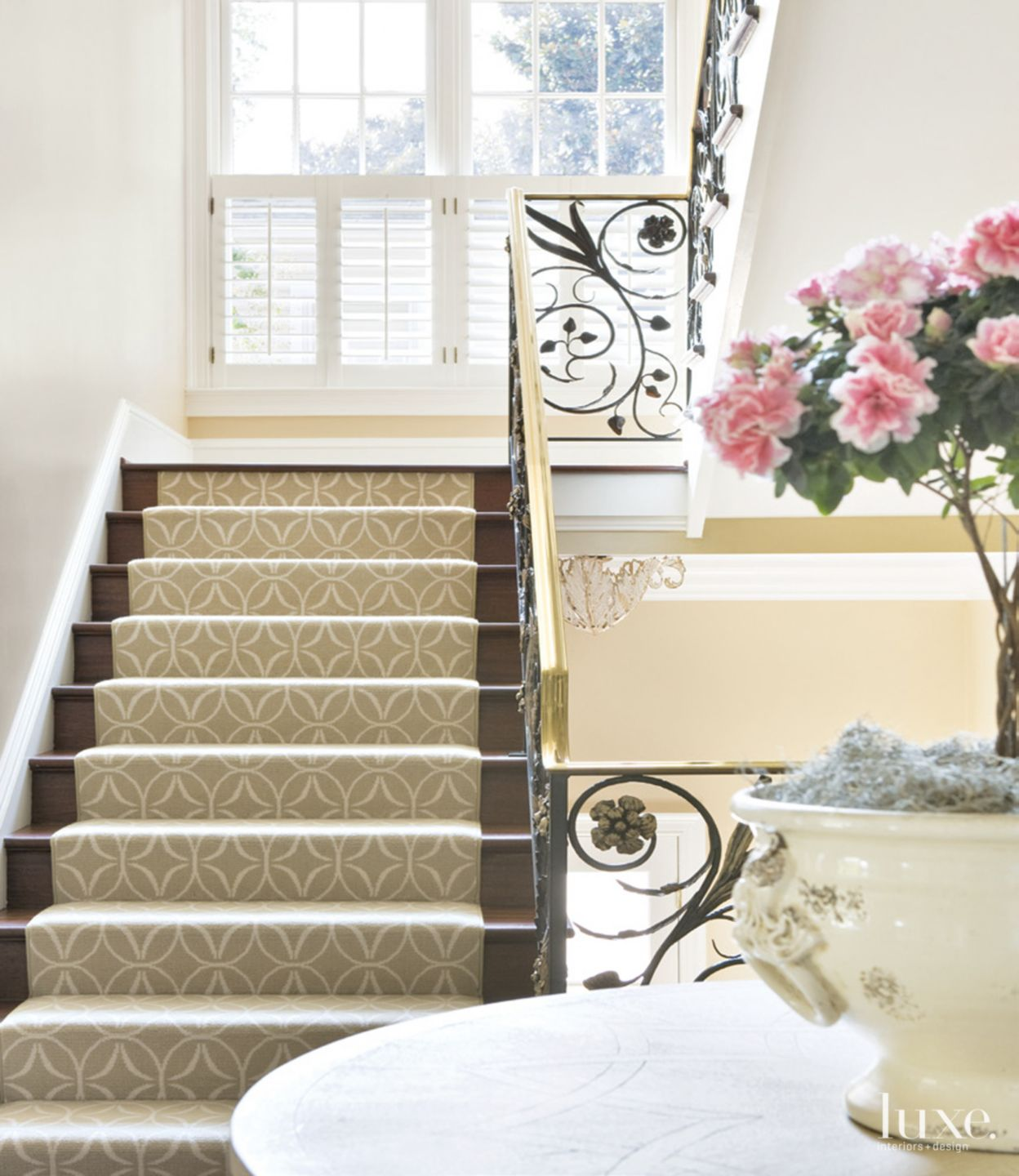 Traditional Cream Entry with Hardwood Staircase