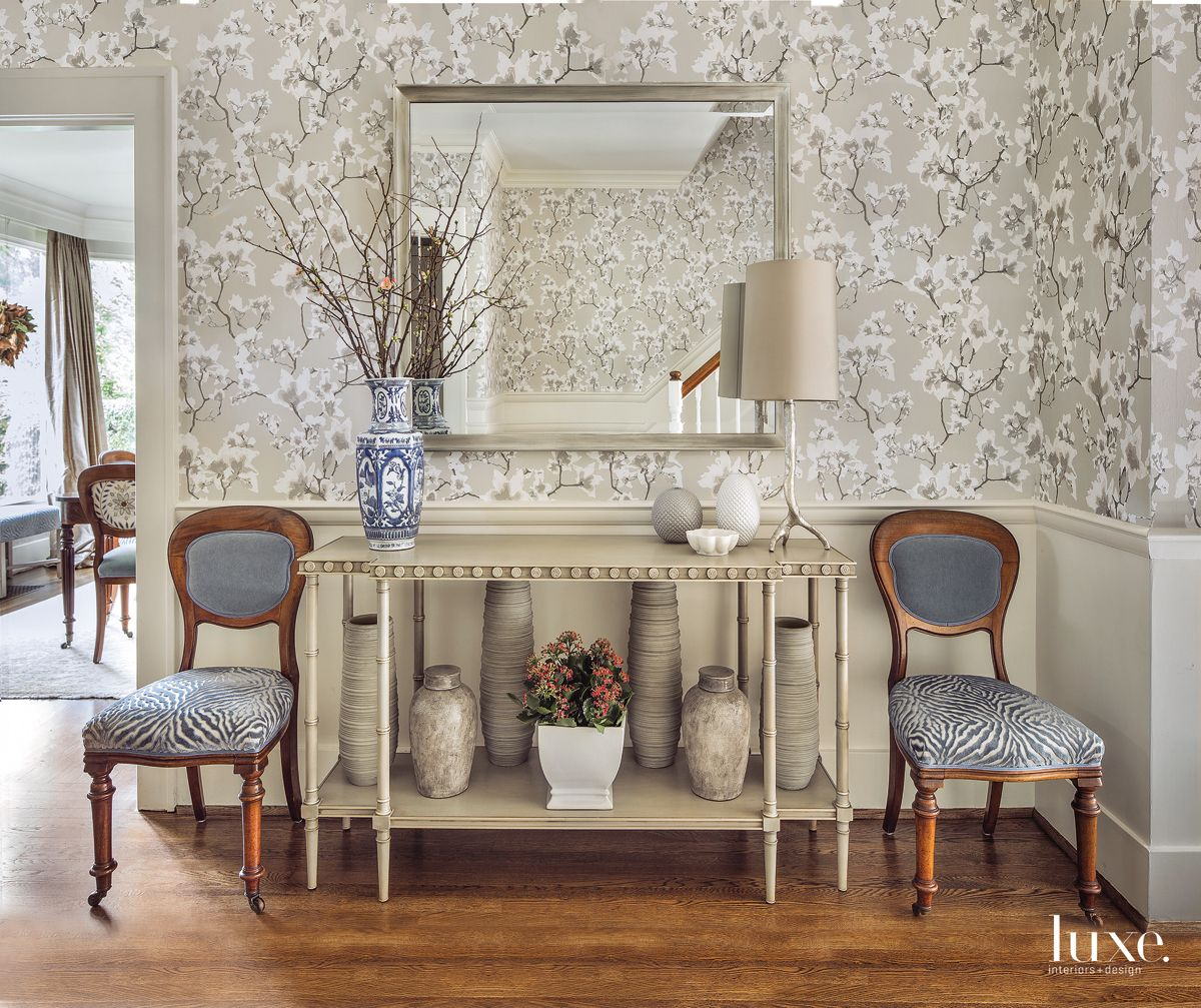Eclectic Neutral Foyer with Carved Console