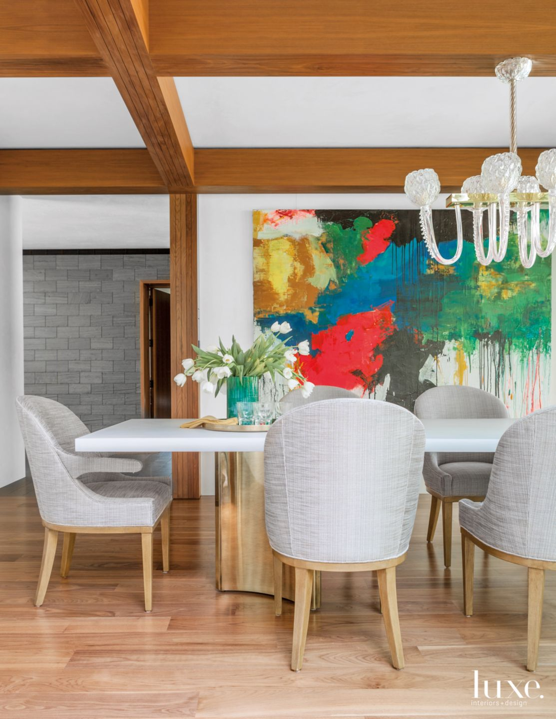 Modern Neutral Dining Room with Dramatic Artwork