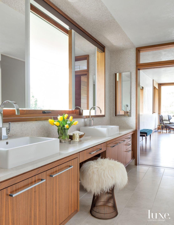 Modern Neutral Bathroom with Brass Stool