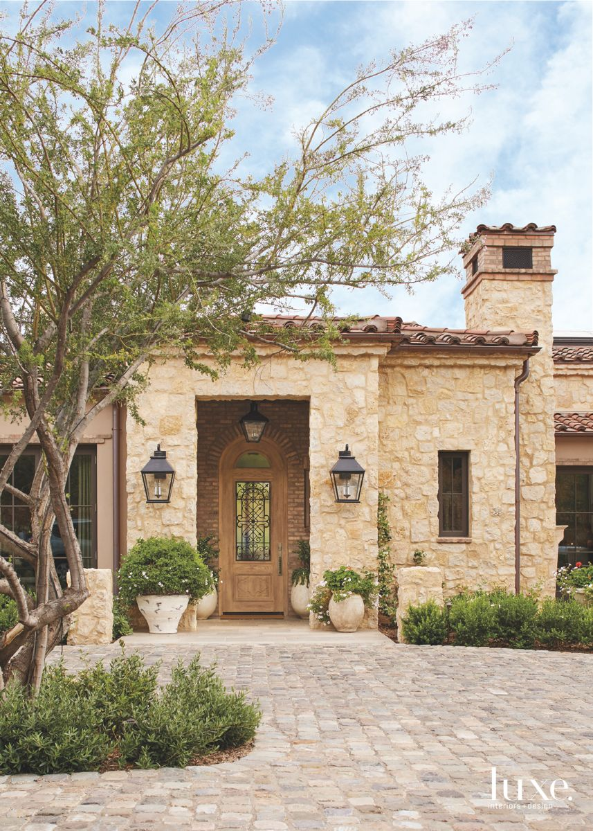 Cream Stone Exterior Mediterranean Style with Lantern Lights