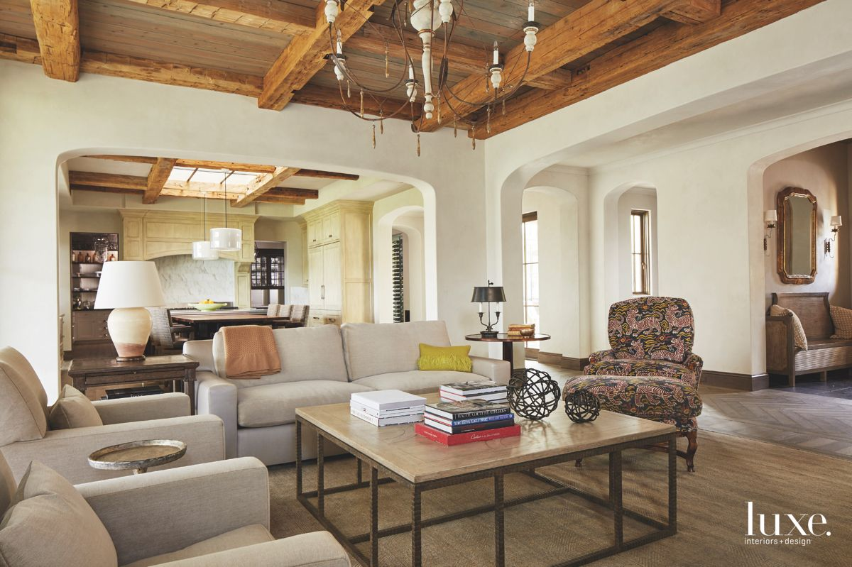 Reclaimed Beam Coffered Ceiling Open Plan Living Room with Chandelier and Antique Chair