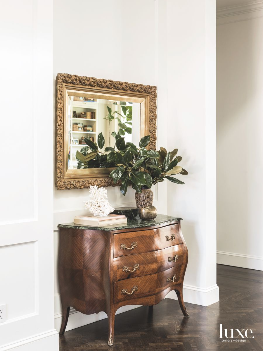 Ornate Gold Mirror Border and Antique Chest Entryway with Plant and Coral