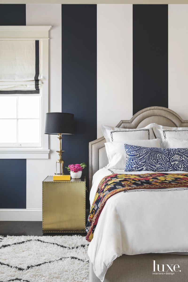 Navy and White Striped Master Bedroom with Fluffy Rug and Eclectic Bedding