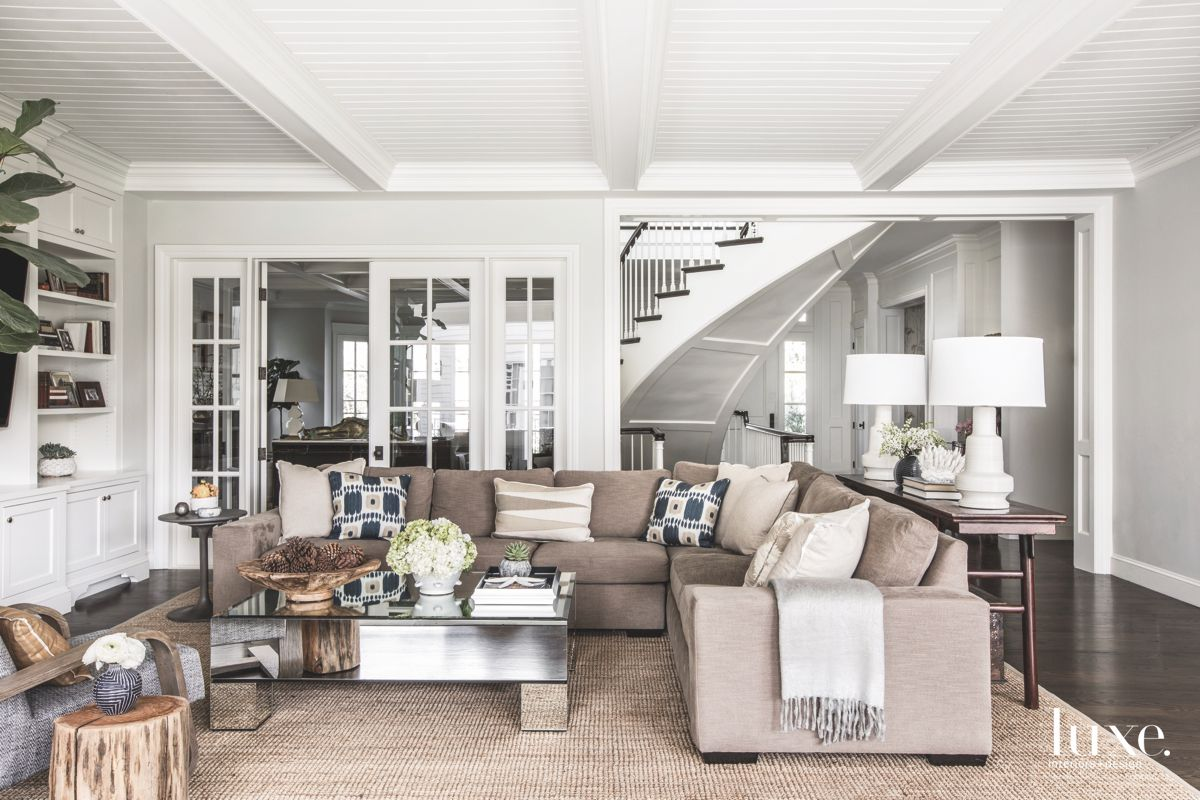 Open and Airy White Family Room with Shelving, Corner Sofa and Rustic Elements