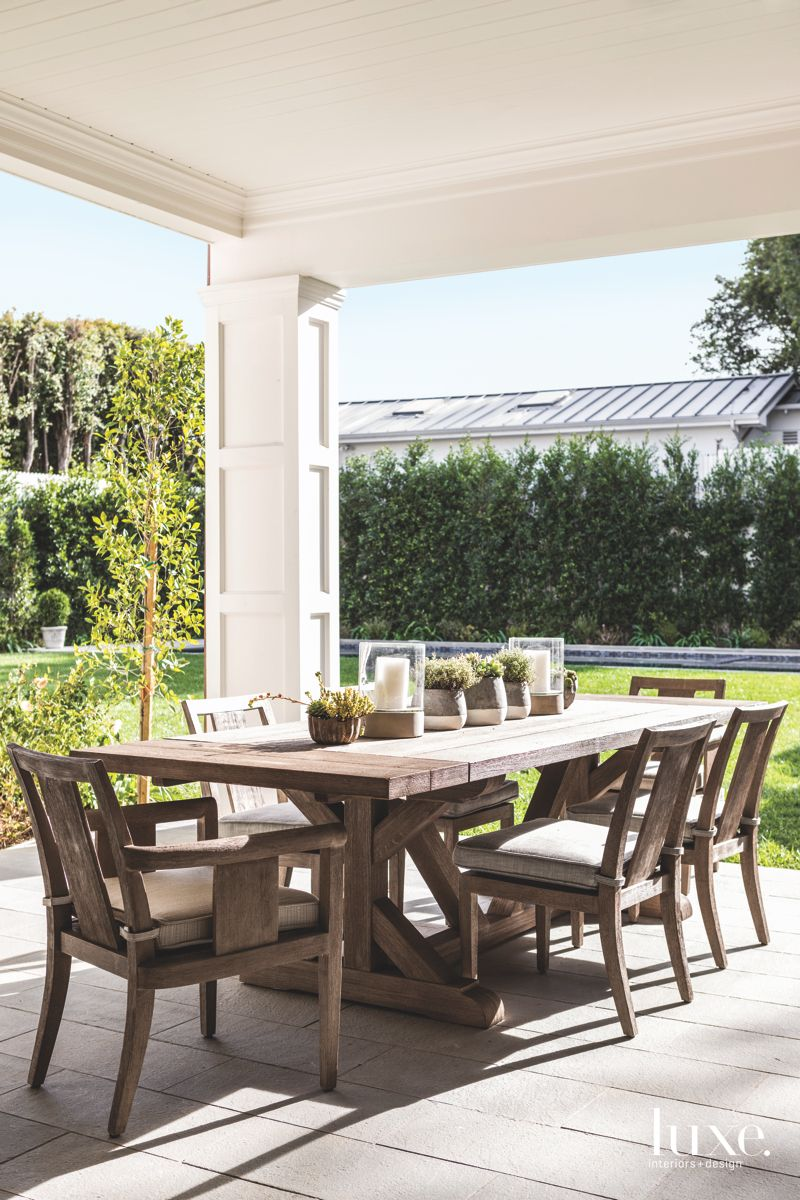 Outdoor Patio Dining Area with Surrounding Tree Border