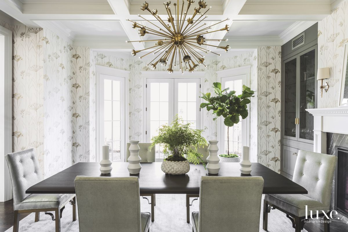 Flower Wallpaper Formal Dining Room with Burst Chandelier and Fireplace