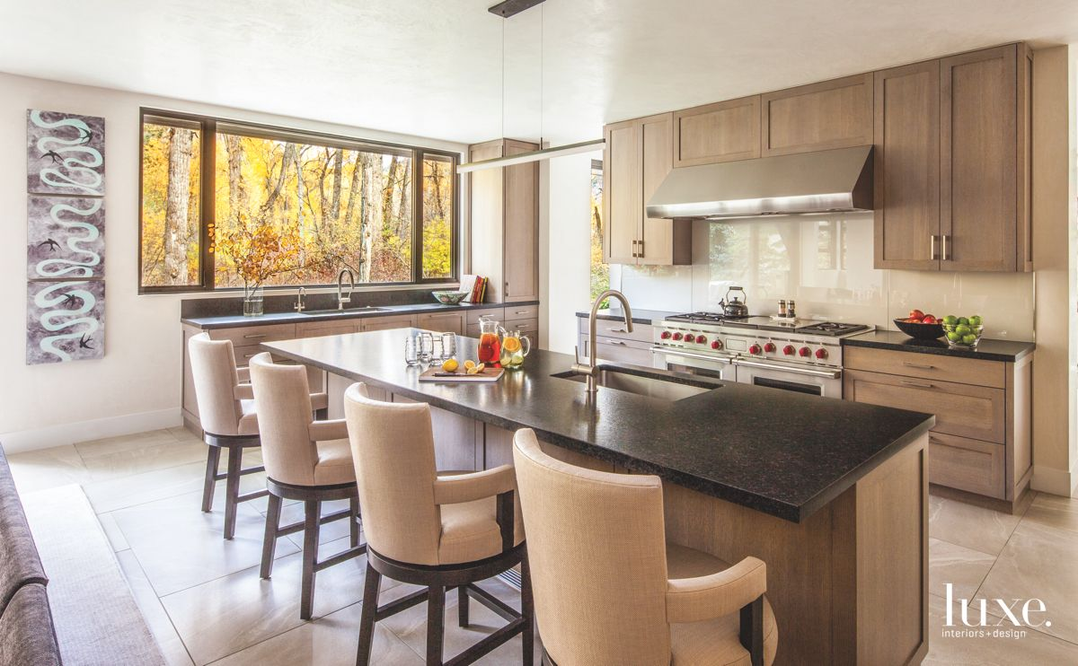 Neutral Comfy Chair Kitchen with Fall Foliage View and Wooden Cabinetry