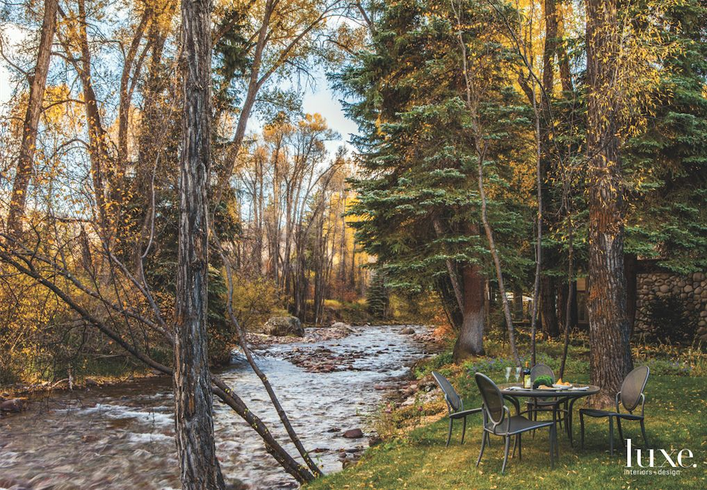 Roaring River Backyard with Outdoor Seating in Fall Foliage