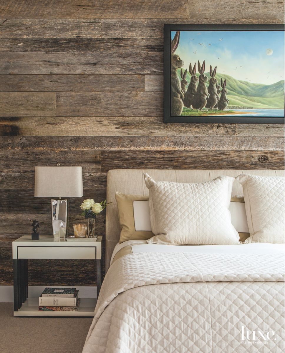 Wooden Siding Master Bedroom with Bunny Rabbit Artwork and White Bedding