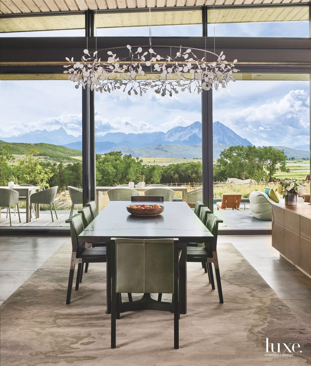 Dining View with a Mountain View and Chandelier