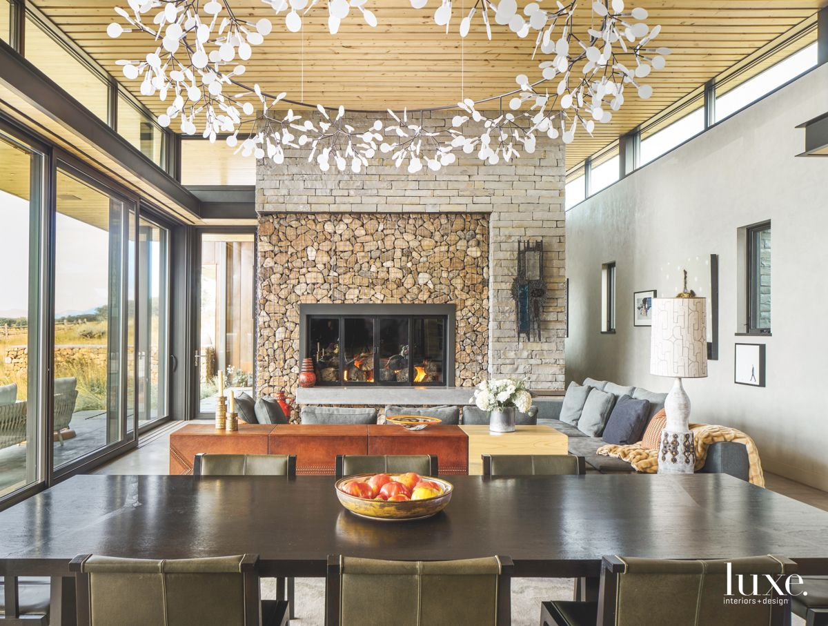 Open Plan Living Area with Fireplace and Captivating Chandelier