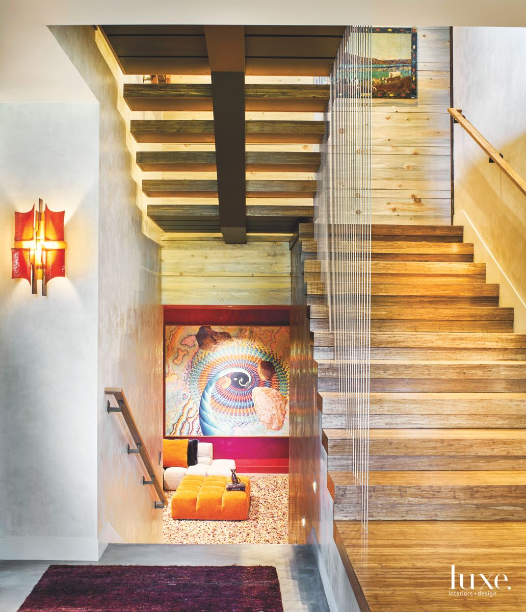 Artful Stairwell with Bamboo Detailing and Abstract Art