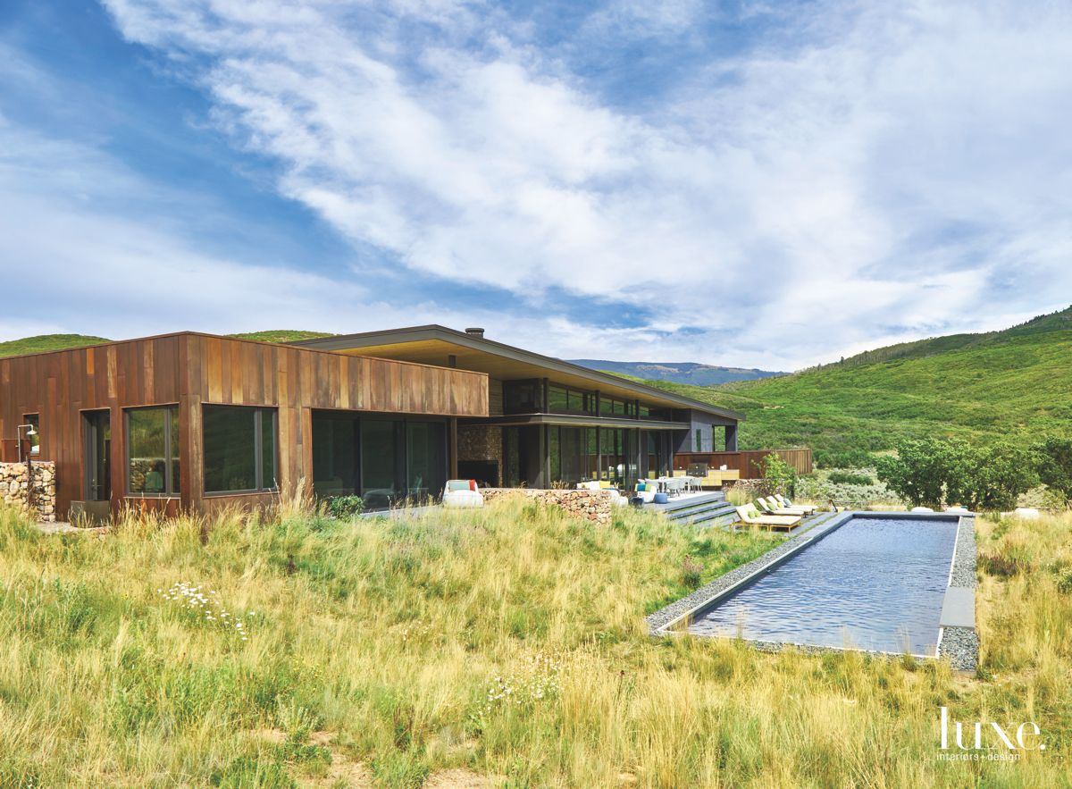 Colorado Pool Surrounded by Lush Greenery and Mountains