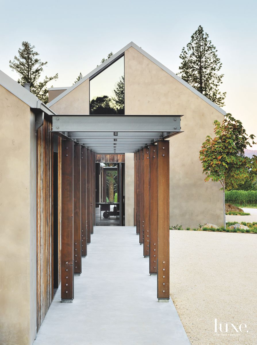 Agrarian and Industrial Walkway with Plaster Exteriors