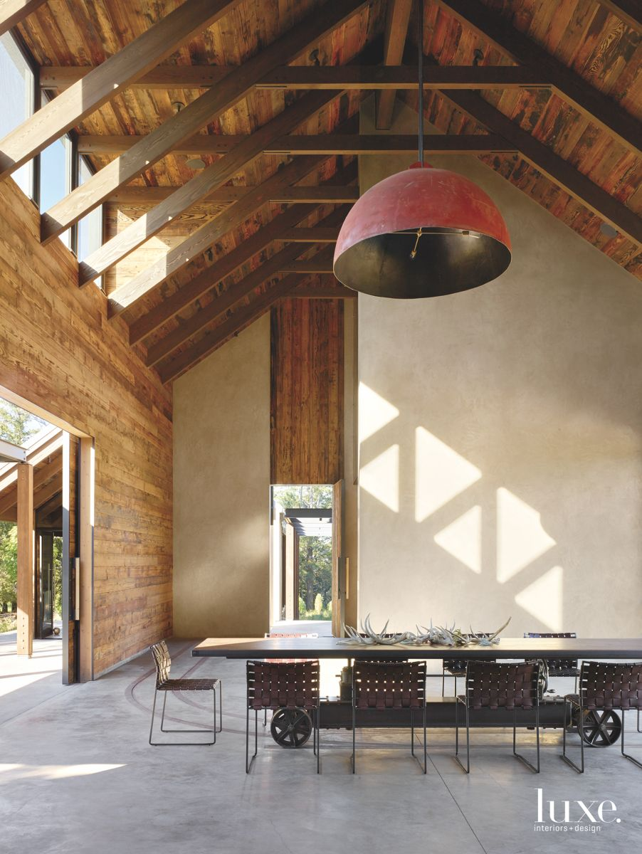 Train Track Dining Room Table with Oversized Light Fixture, Wicker, and Clerestory Windows