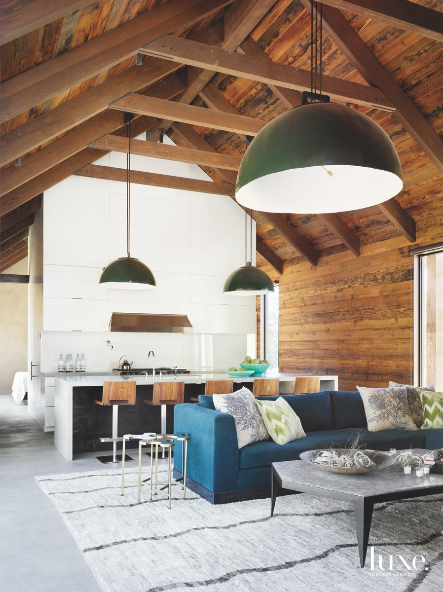 Oversized Light Fixtures Vaulted Ceiling Living Room and Kitchen with Wooden Beams