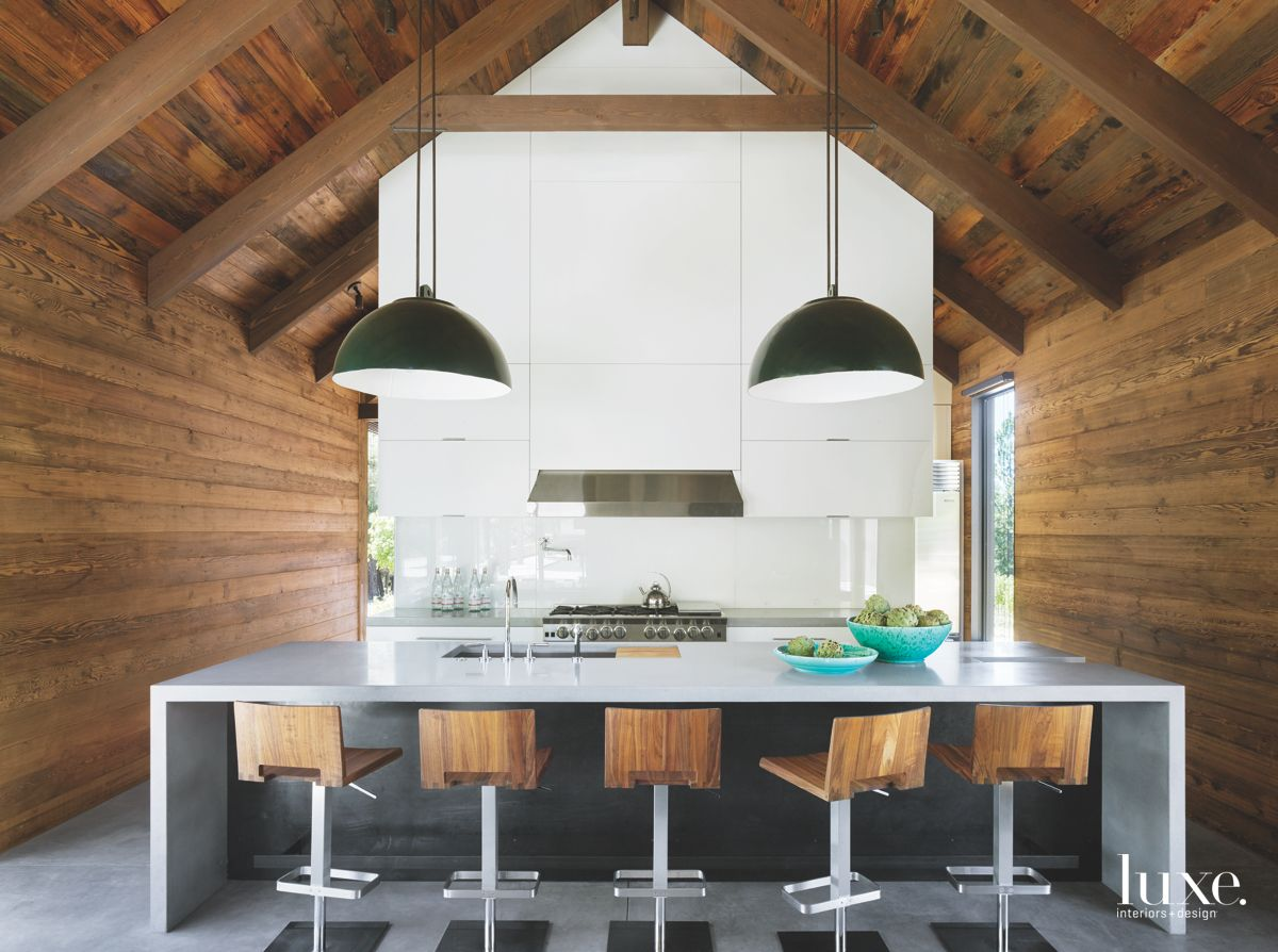 Wooden Walled White Kitchen with Barstools and Painted Backsplash