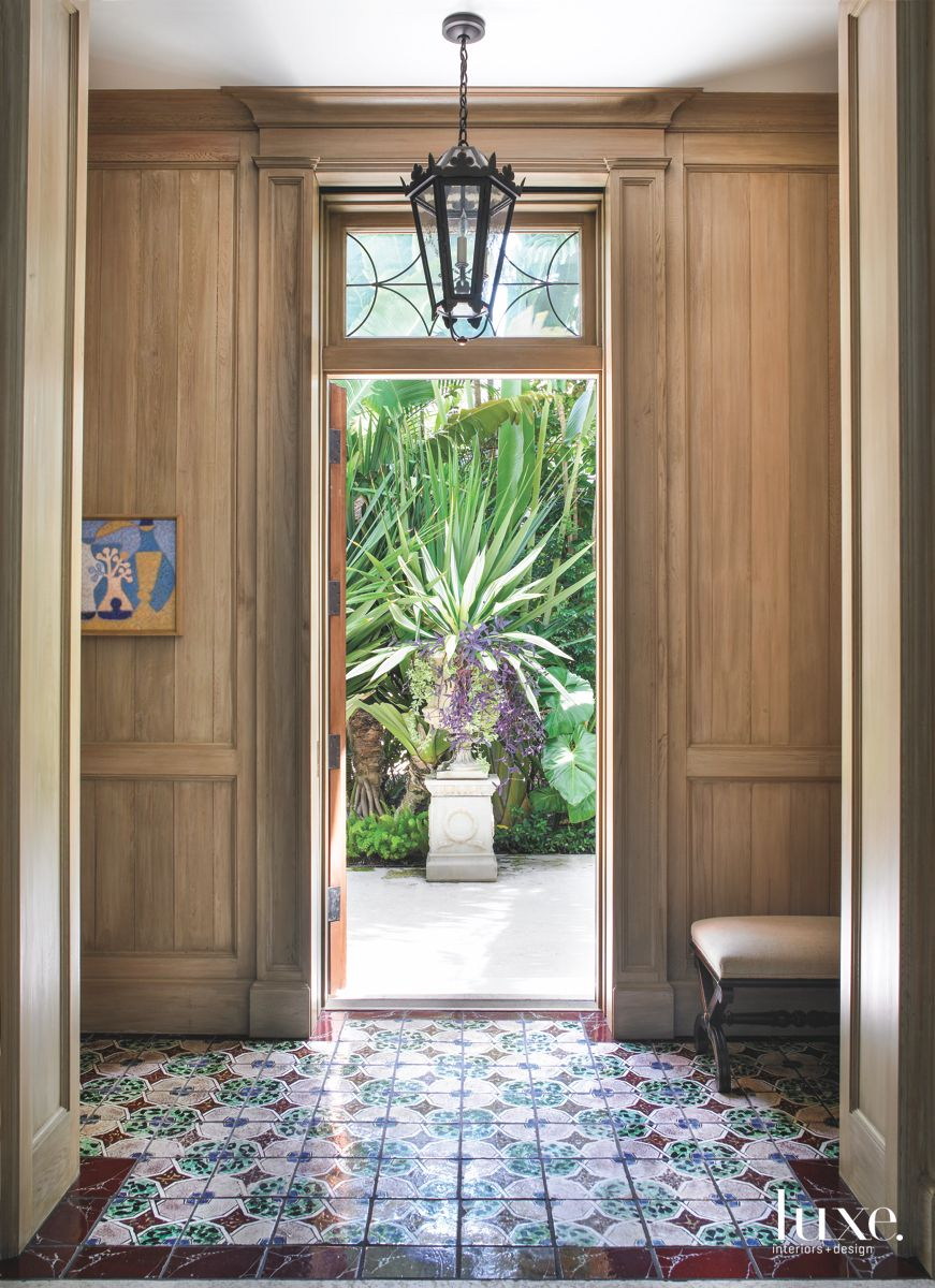 Limed-Oak Paneled Entry Vestibule with Portuguese Tiles