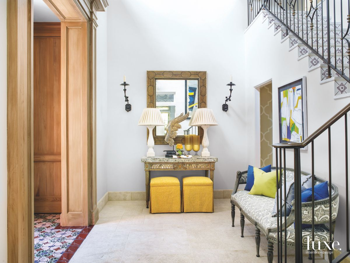 Mixed and Matched White Entryway with Yellow Ottomans