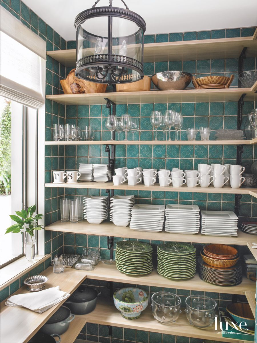 Old-World Inspired Well-Lit Pantry with Storage Abound