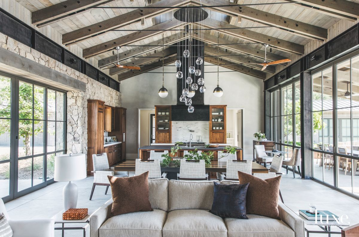 Vaulted Ceiling Open Space Living Room Dining Room and Kitchen with Chandelier and Glass
