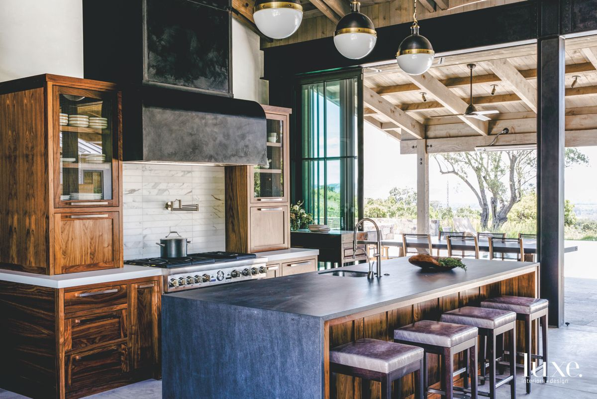 Black and Wood Kitchen with Spherical Pendant Lighting and Barstools