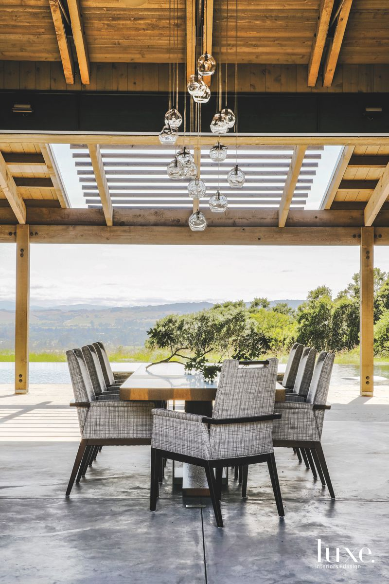 Covered Outdoor Dining Room with Vineyard Views and Crystal Sphere Chandelier
