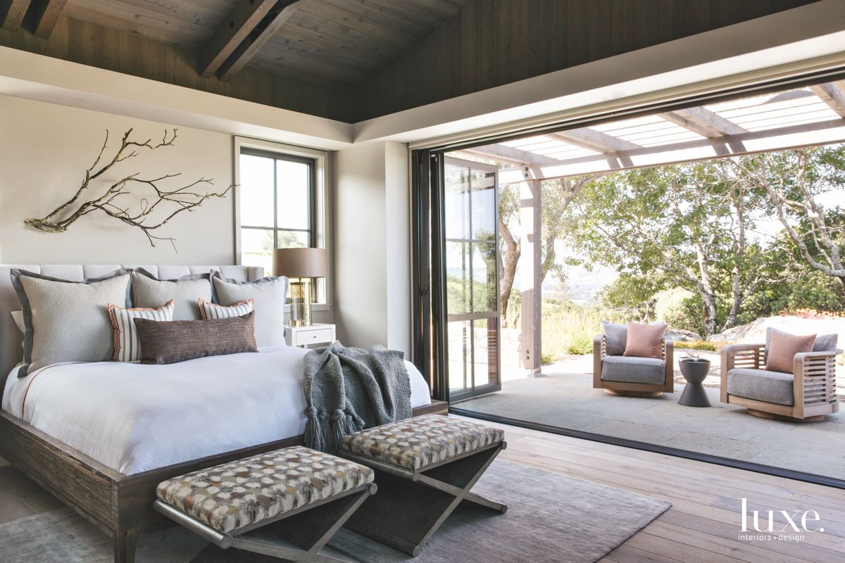 Branch Master Bedroom with Open Flow to the Outdoors and Patio Furniture
