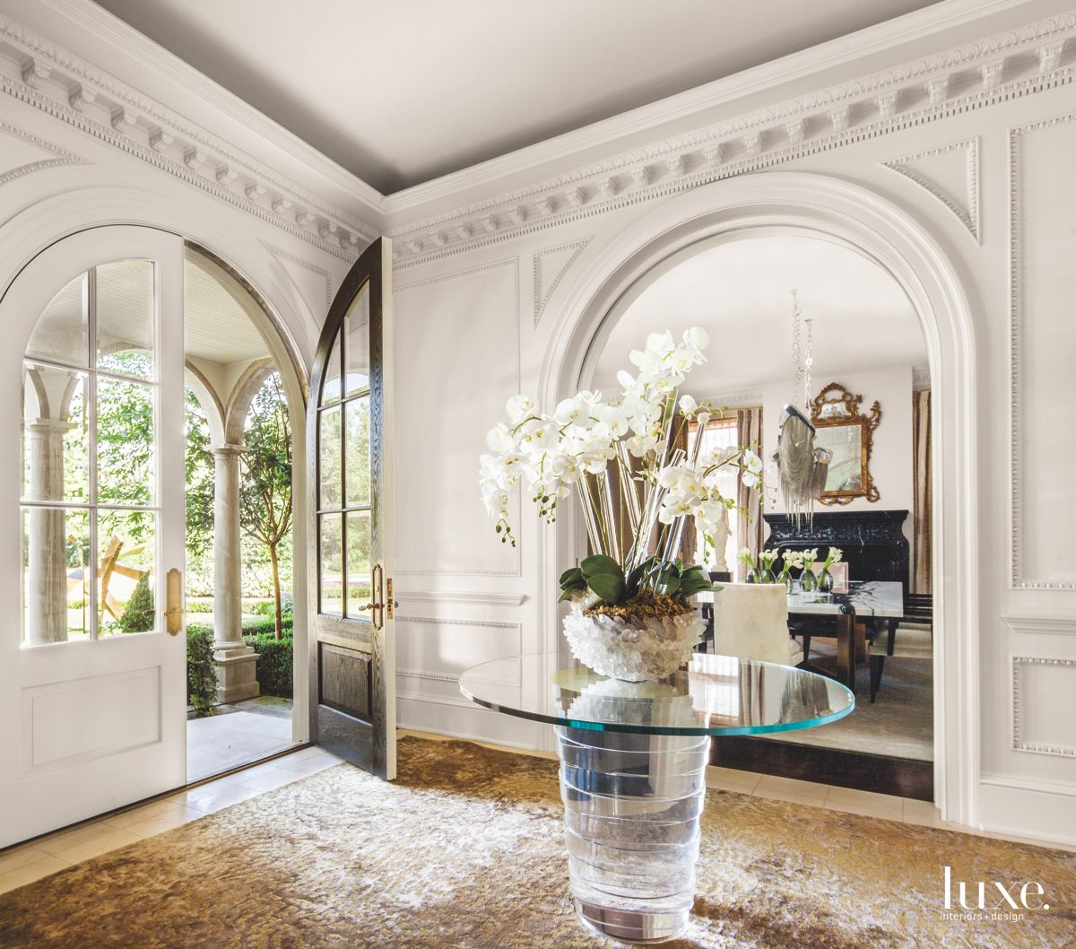 Ornate Millwork Entry with Flowers and Plenty of Light