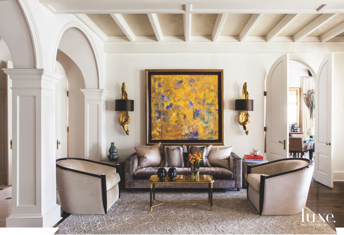 Bright Yellow Painting in a Neutral Living Room