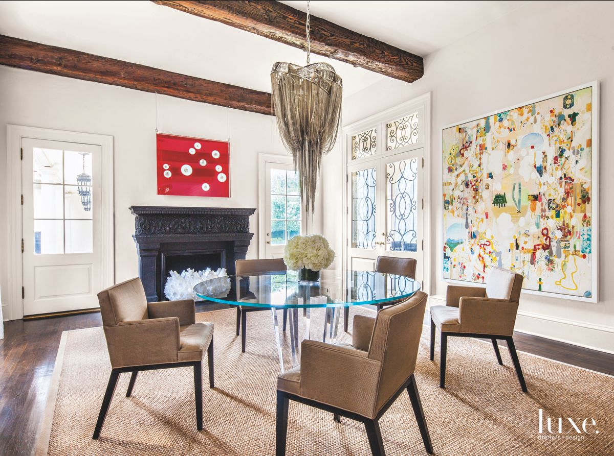 Breakfast Room with Chandelier, Fireplace, and Artwork