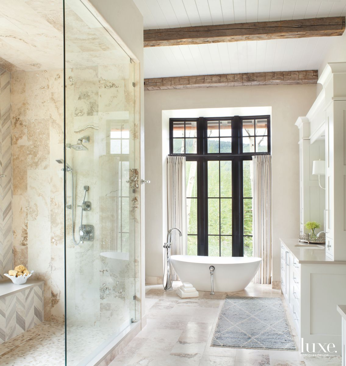 Neutral and Soft Blue Master Bathroom with Black Pane Windows and Vanity