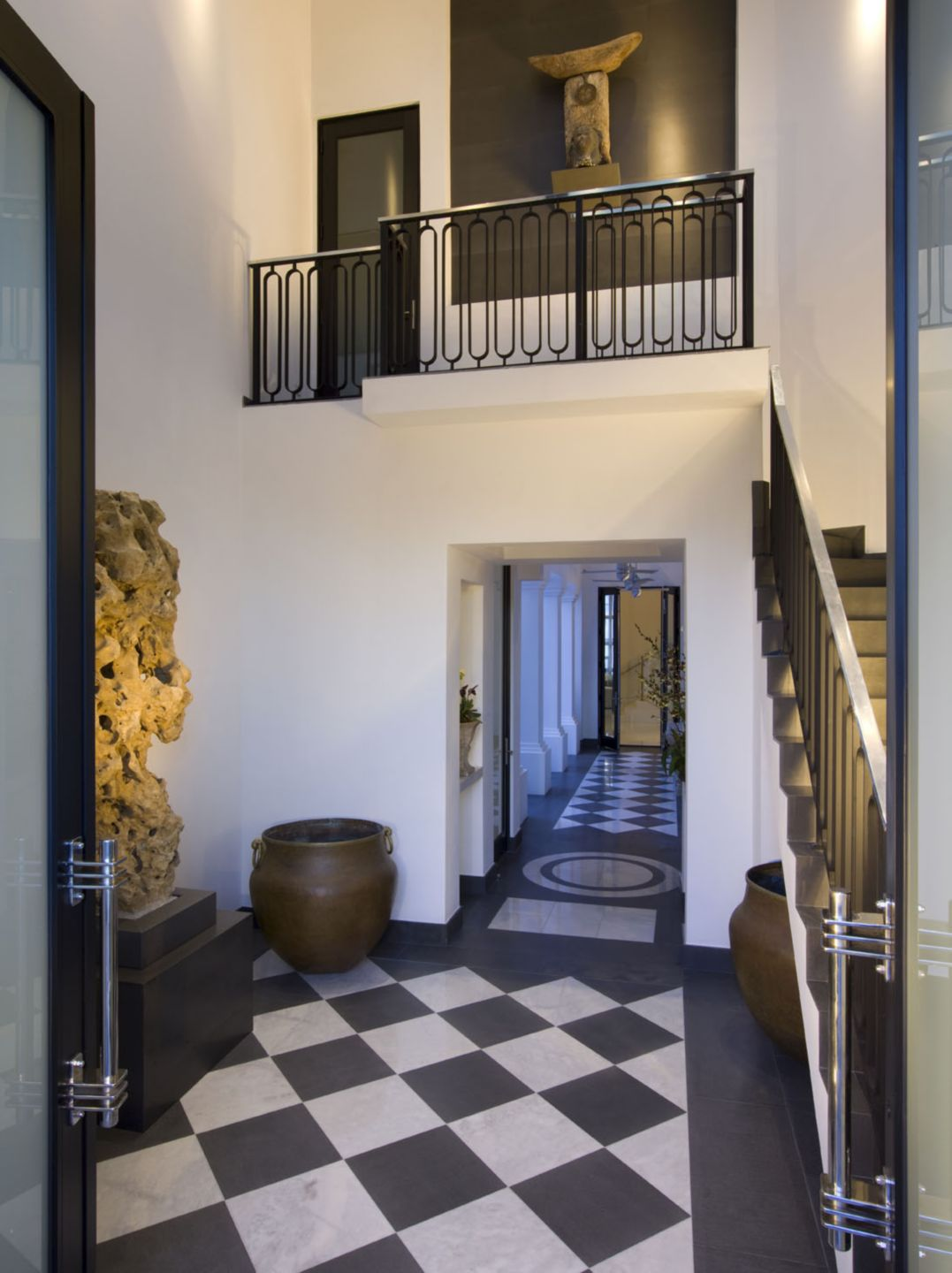 Modern Neutral Staircase with Multiple Sculptures