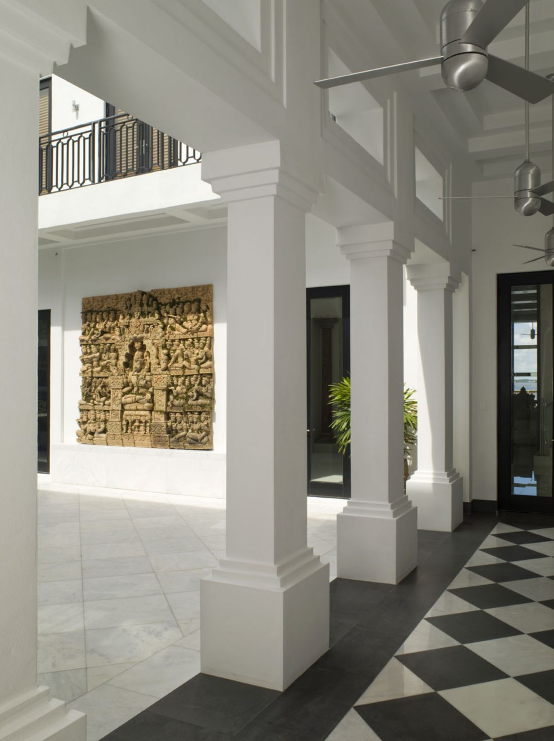 Modern Neutral Courtyard with Indian Temple Wall Relief