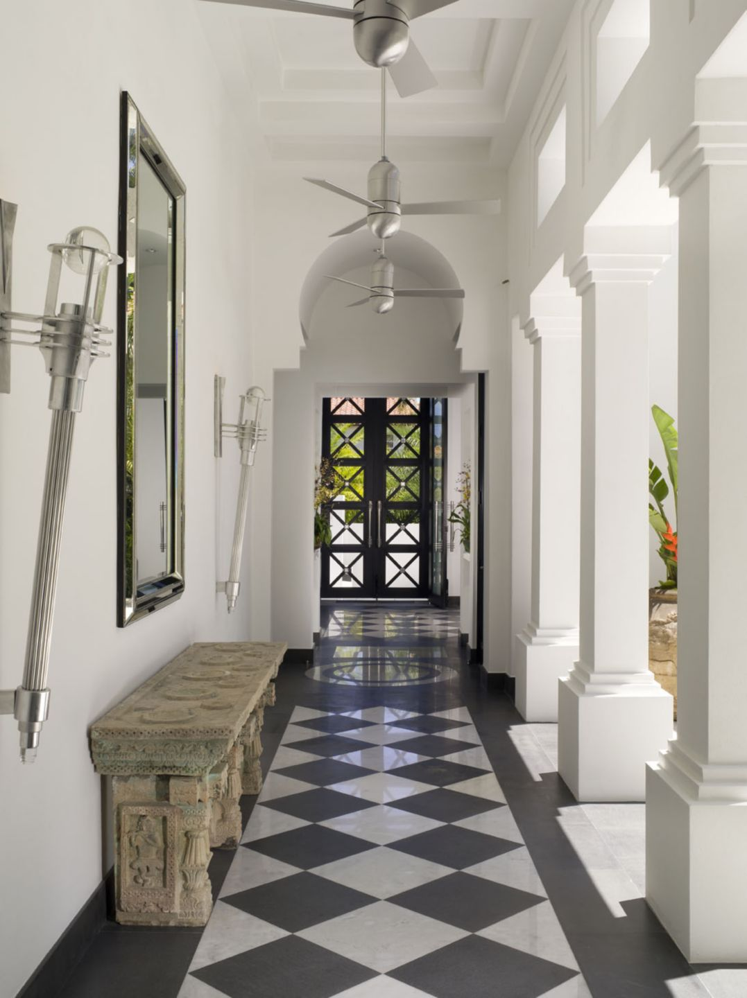 Modern White Corridor with Ancient Stone Altar Table