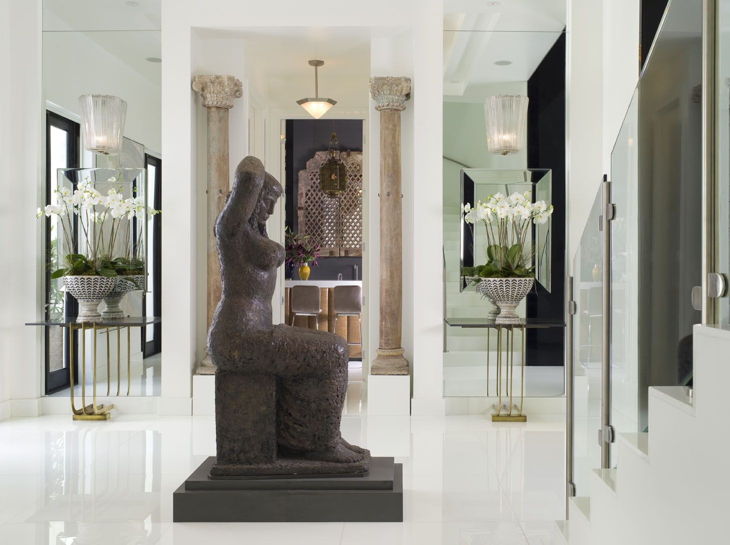 Modern White Hall with Large Sculpture