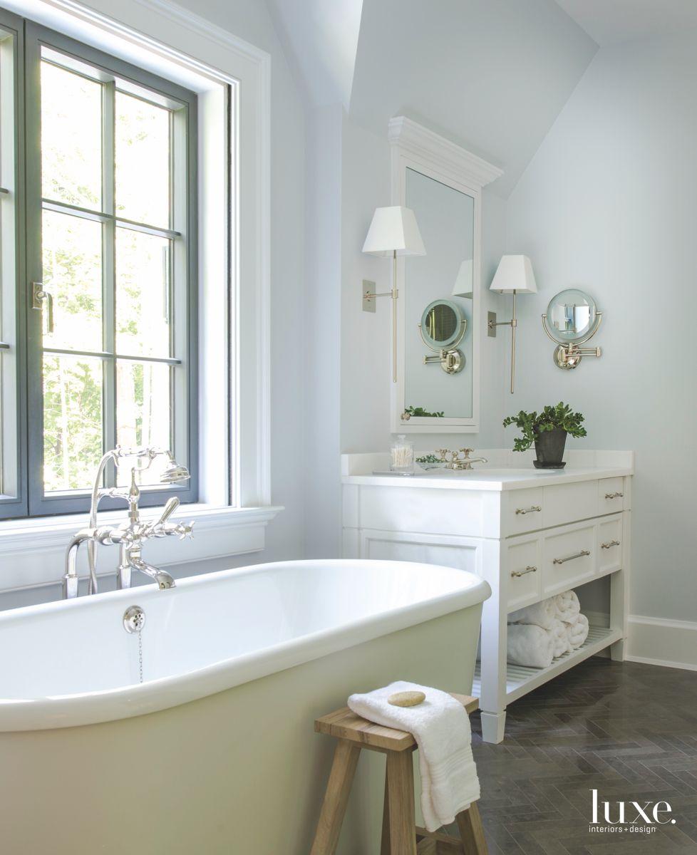 Light Green Freestanding Bathtub in All-White Master Bathroom