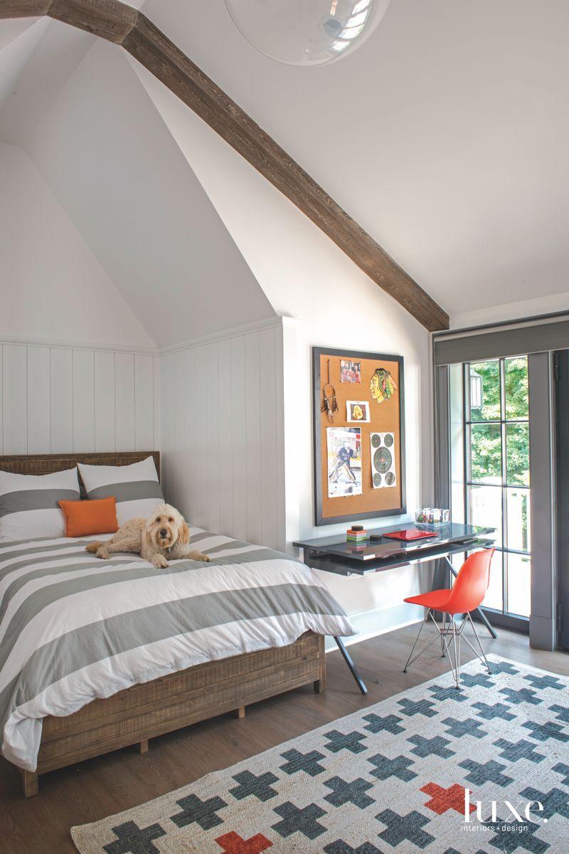 Pop of Orange Third Floor Bedroom with Dog