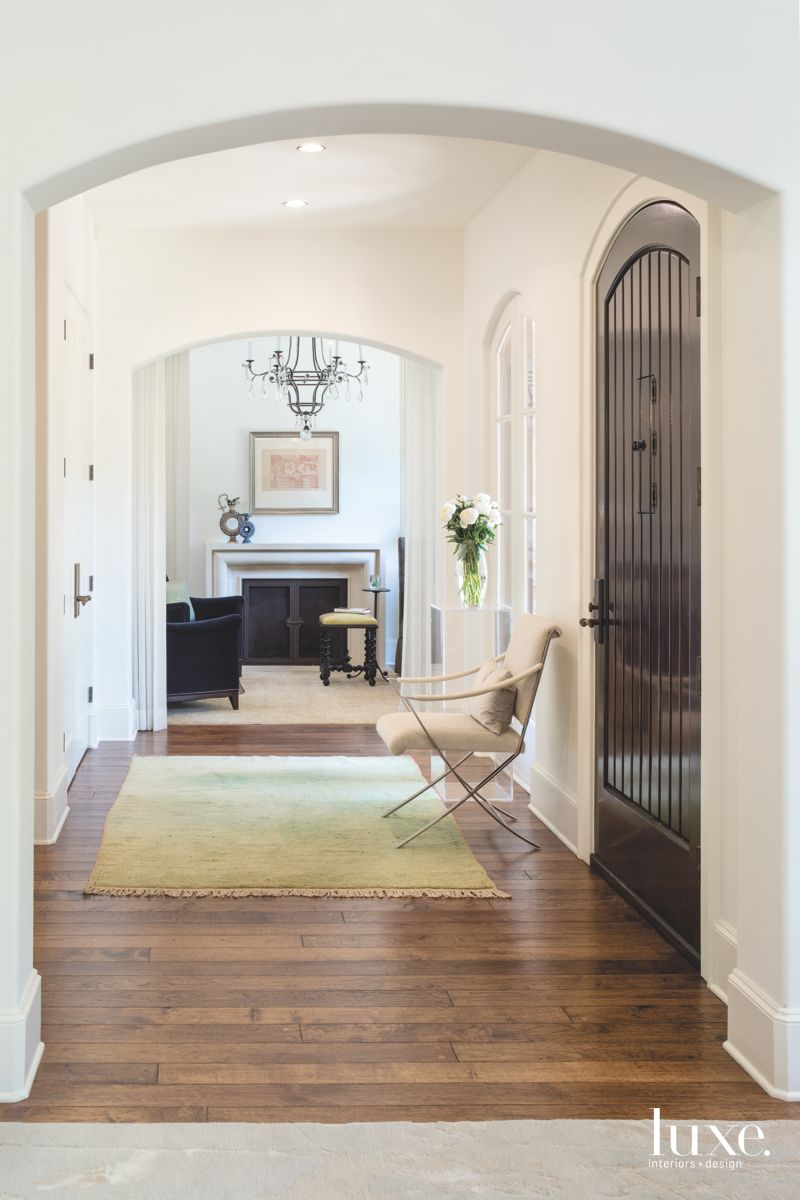 Off-White Entry with Moroccan Rug and Pecan Floors