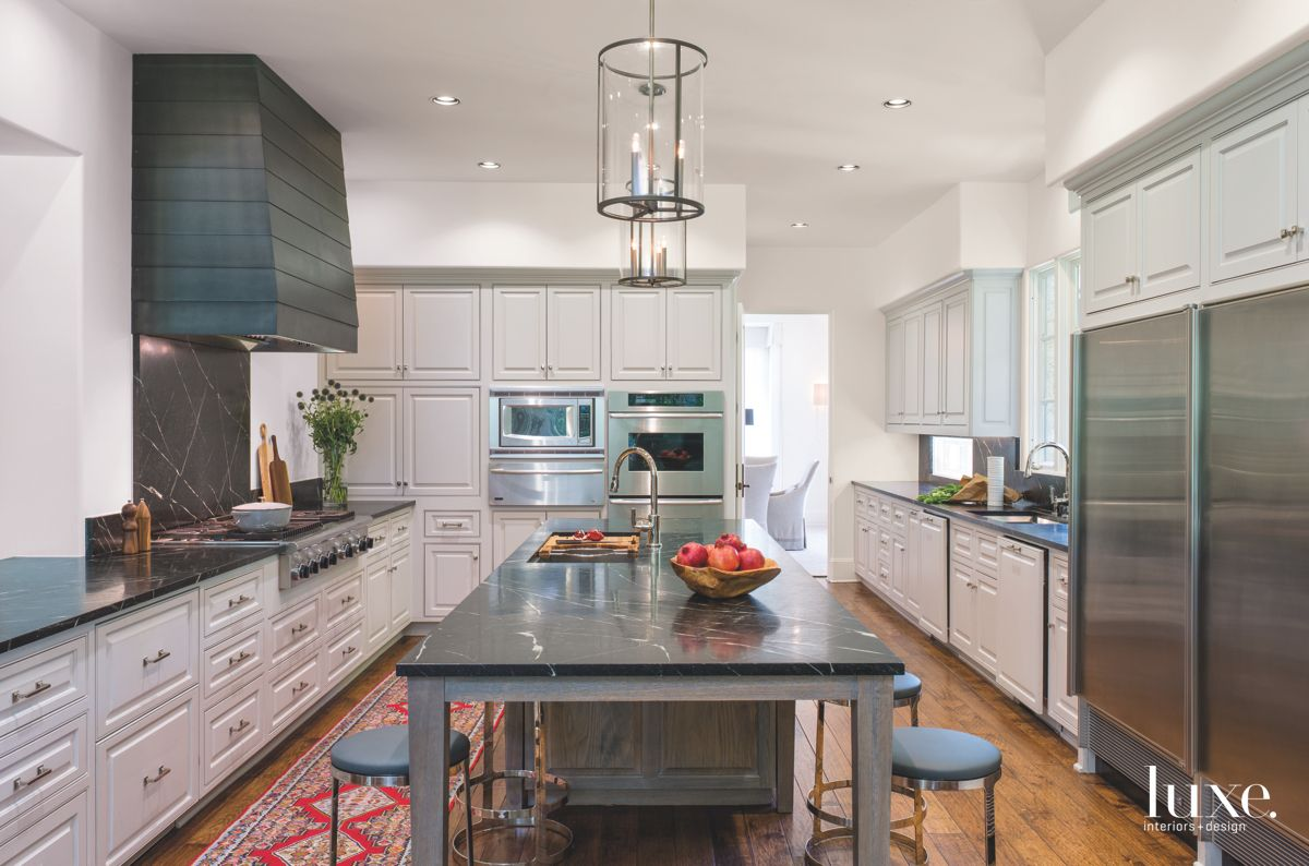Light Gray Kitchen with Dark Countertops and Island