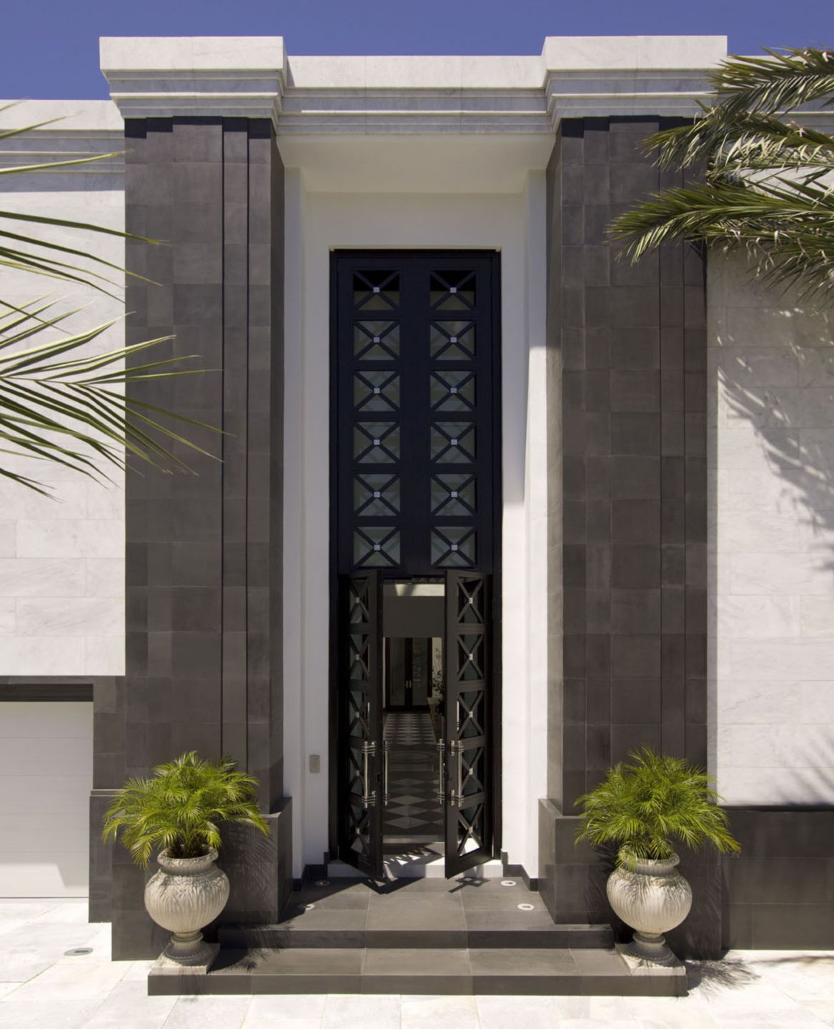 Midcentury Modern Exterior with Art Deco Doors