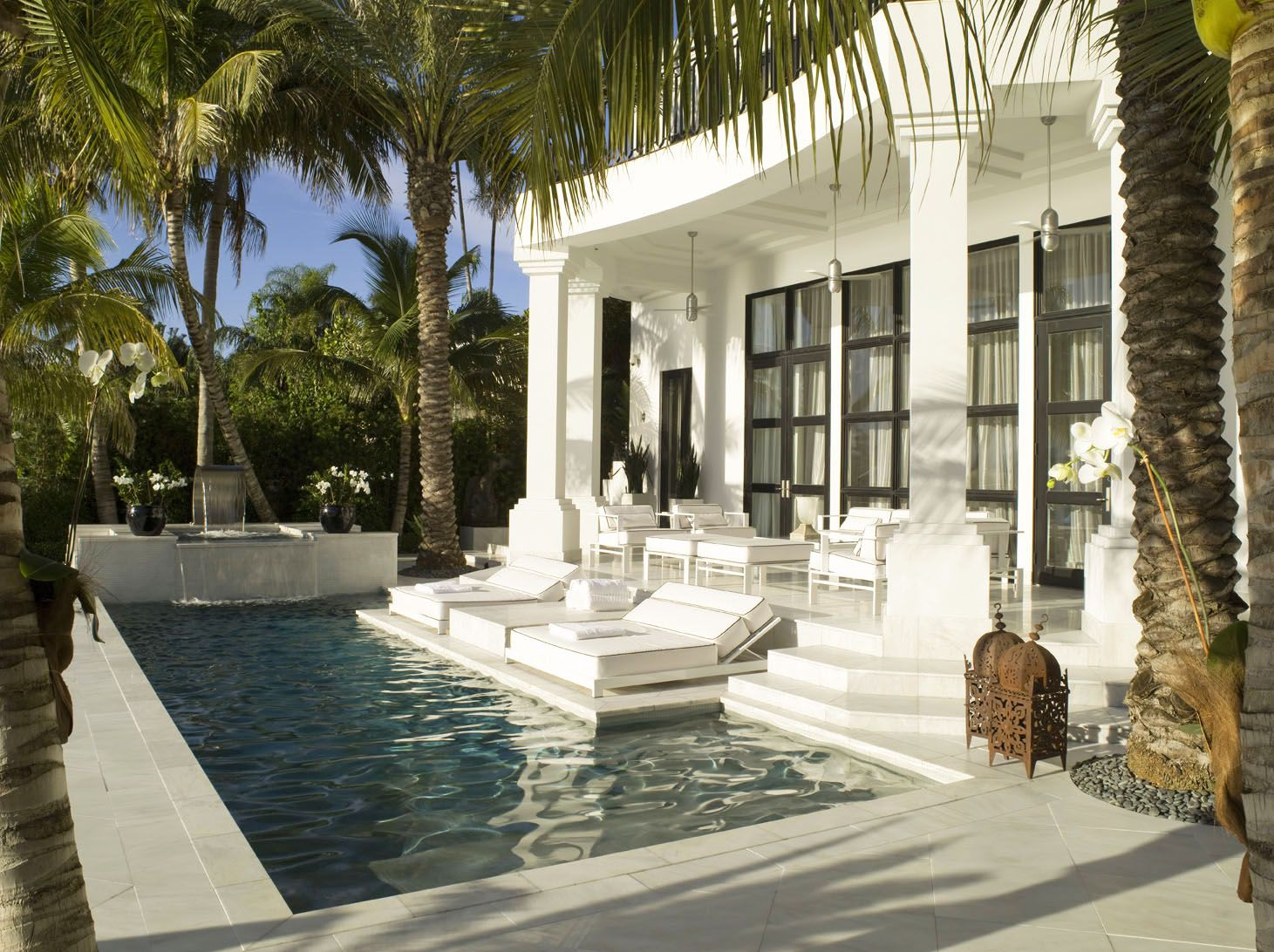 Modern White Poolside Area with Moroccan Antiques