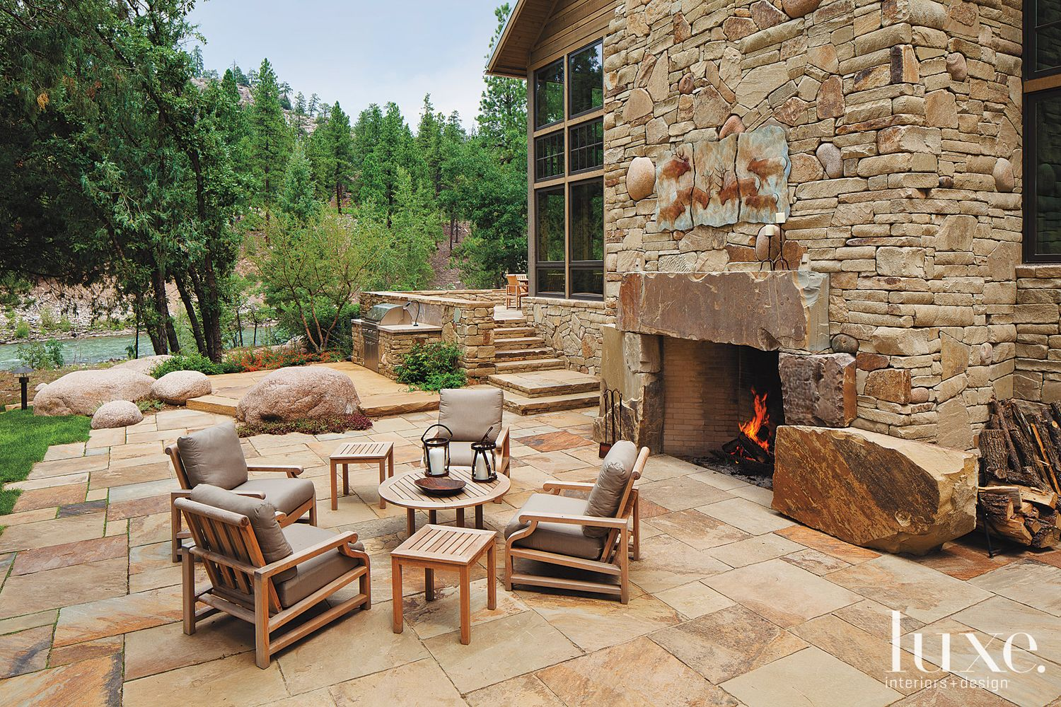Country Neutral Stone Patio with Outdoor Fireplace